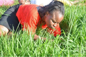 A woman eats grass in South Africa. Photo Courtesy: African Spotlight