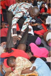 Pastor steps on believers. Photo courtesy of African Spotligh