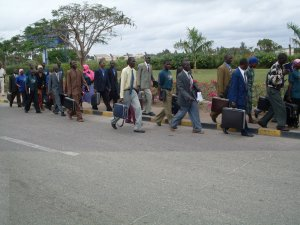 Members of Tanzania's Sabato Masalia walking to the airport. Photo courtesy of charaz.blogspot.com
